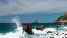 Stormy White Waves Crashing Against A Large Black Rock. Seascape From Persico Beach (Spiaggia Del Persico) A Hidden Gem In Campiglia, La Spezia, Italy.