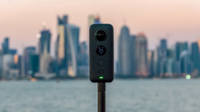 Insta360 One X 360 Camera On A Tripod With Cityscape In The Background