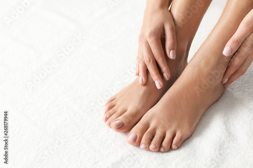 Foto op Canvas Pedicure Woman with beautiful feet on white towel, closeup. Spa treatment