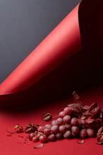 A Bunch Of Red Grapes On A Red Background