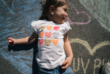 Girl Laying On Chalk Art