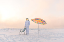 Person In Spacesuit Resting In Winter