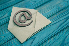 The Letter, Sign The E-mail On A Wooden Background.  Correspondence.