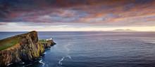 Lighthouse On A Rocky Outcrop
