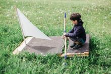 Little Boy Pretending To Sail ...