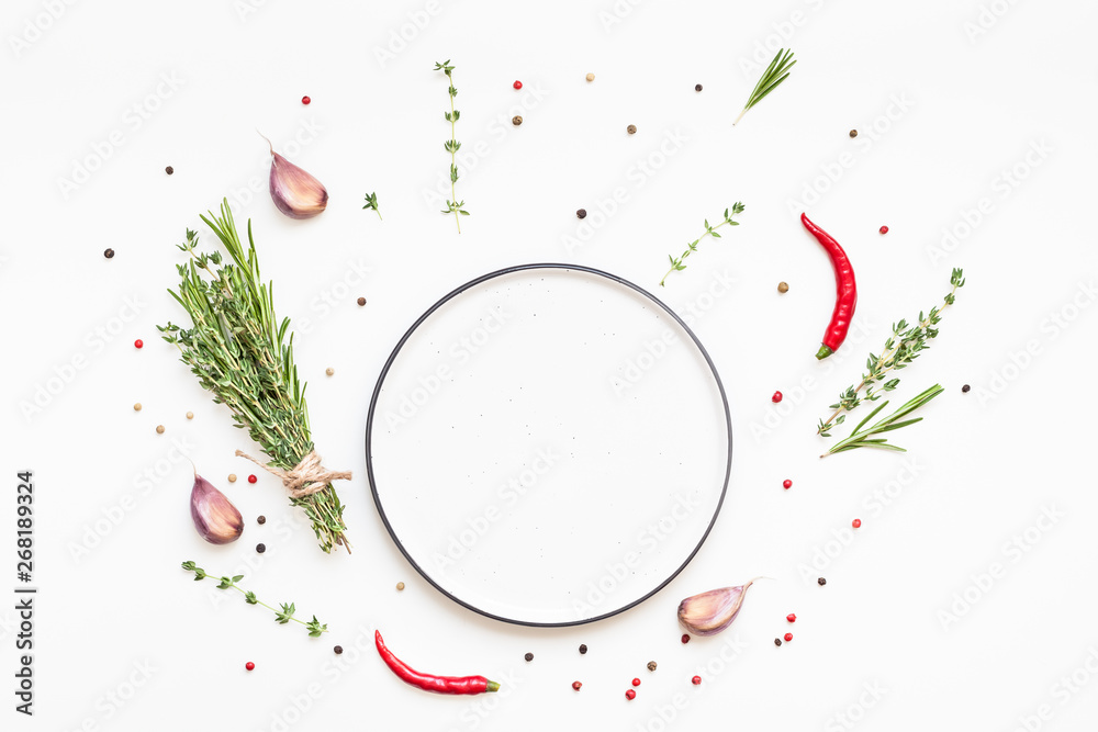 Fototapety, obrazy: Empty plate with greens herbs and spices around