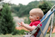 Baby In Pushchair