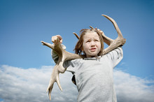 A Young Child Carries A Deer A...