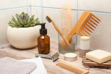 Zero Waste Bathroom Accessories, Metal Safety Razor, Wooden Comb, Deodorant, Shea Butter, Solid Soap, Wooden Toothbrush, Olive Oil Make Up Remover In A Glass Container, Nail Brush, Aloe Vera.