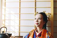 Asian Woman In Traditional Kimono Clothing