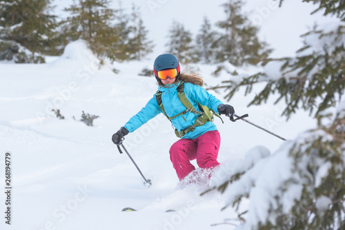 Young female freeride skiing