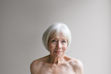 Senior Topless Woman On Simple...