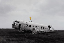Woman Stands On Old Wreckage Of DC Plane