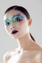 Beautiful Model Posing In A Studio With Glitter Makeup
