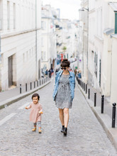 Smiling Mom And Baby Walking Streets Of Paris