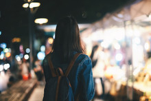 Young Traveller Woman Walking On City Street At Night.