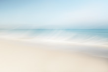 Blurred Waves At The Beach On A Clear Day In Spring