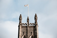 Gothic Tower  With  Flag On The Top