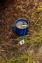 A Camping Mug Filled With Tea ...