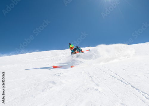 Freeride skier in fresh powder snow