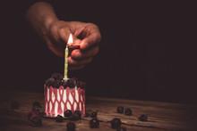 Hand Lights A Candle A Festive...