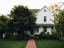 Old White Victorian Farmhouse In A Small American Town