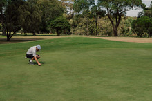 Senior Man Playing Golf On The Public Golf Course