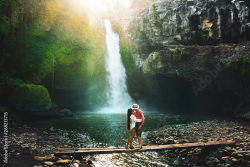 Foto auf Leinwand Schwarz Active lifestyle couple travel in Asia and explore amazing waterfall hidden in tropical rainforest jungle