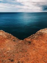 Red Soil And Deep Blue Atlantic Ocean