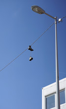 Pair Of Boots Thrown Over A Wire