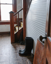 Boots Left In Hall Of Old Farm House
