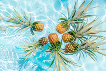 A Group Of Pineapples In The Water