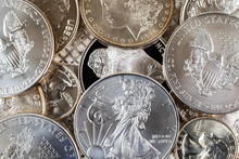 Close Up Of Silver Coins And Bullion