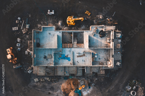 Obraz na plátně Aerial birds eye image of the frame of a house being built on a construction sit