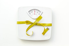 Bathroom Scales And Measuring Tape For Weight Loss Concept On White Background Top View