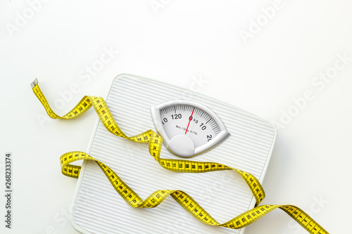 Fotomural bathroom scales and measuring tape for weight loss concept on white background t