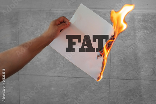 Foto Burn fat text on burning paper