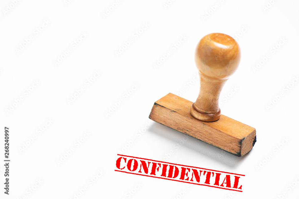 Fototapeta Rubber stamp with confidential  sign on white background.