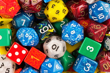 Top View On A Stack Of Role Playing Game Dice As Abstract Background. Macro Details.