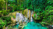 A Tropical Jungle Waterfall In...