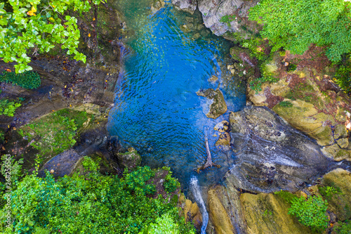 Photo Stands Forest river A tropical jungle waterfall in the hidden slopes of one the most beautiful islands in the Philippines. The Island of Bohol.