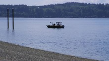 Small, Nondescript Fishing Floating Near Dock At Camano Island State Park, WA State 10sec/60fps Version 4