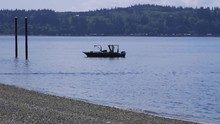 Small, Nondescript Fishing Floating Near Dock At Camano Island State Park, WA State 20sec/24fps Slow Motion. Version 1