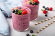 Leinwandbild Motiv Fresh mixed berry smoothie topped with granola