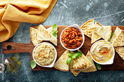 Valokuvatapetti Mediterranean mezze board with pita and dips