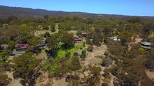 Aerial Tracking Shot Towards Houses Situated At The Top Of A Hill In The Mount Lofty Ranges, Adelaide - South Australia. Dry Grass And Bushfire Risk.