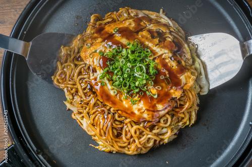 お好み焼き 広島焼き Okonomiyaki is a Japanese-style pancake