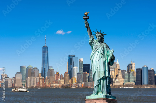 Spoed Foto op Canvas New York The Statue of Liberty over the Scene of New york cityscape river side which location is lower manhattan,Architecture and building with tourist concept