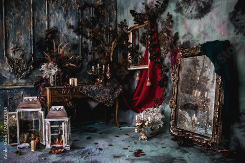 Obraz na plátne dark decor with dried flowers, vases, chandeliers, textured fabrics against the