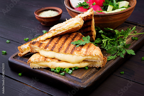 Fototapeta American hot cheese sandwich. Homemade grilled cheese sandwich for breakfast. obraz